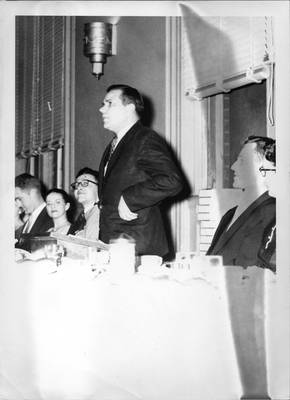 Aycock, speaking at a banquet.