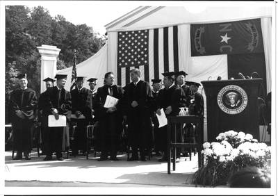 Aycock, stands right side of Kennedy.